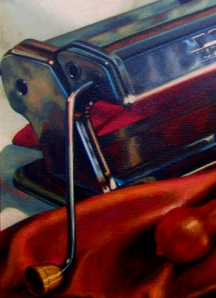 Detail close up of the pasta machine in a still life painting.