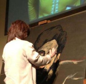 Painting the face of Christ as a form of worship during Easter worship services